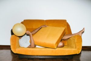 Introvert hiding on a couch